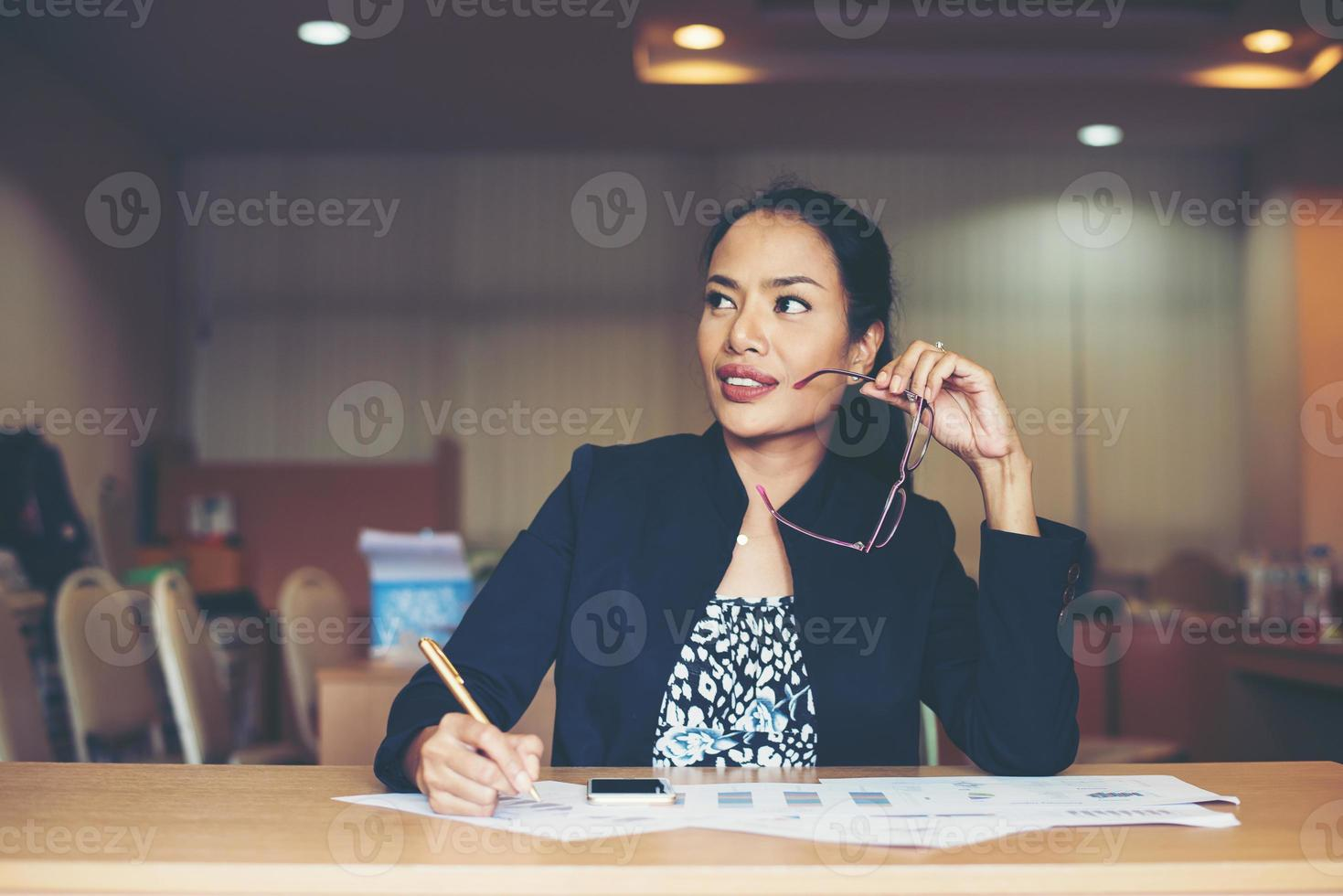 Business woman working at office photo