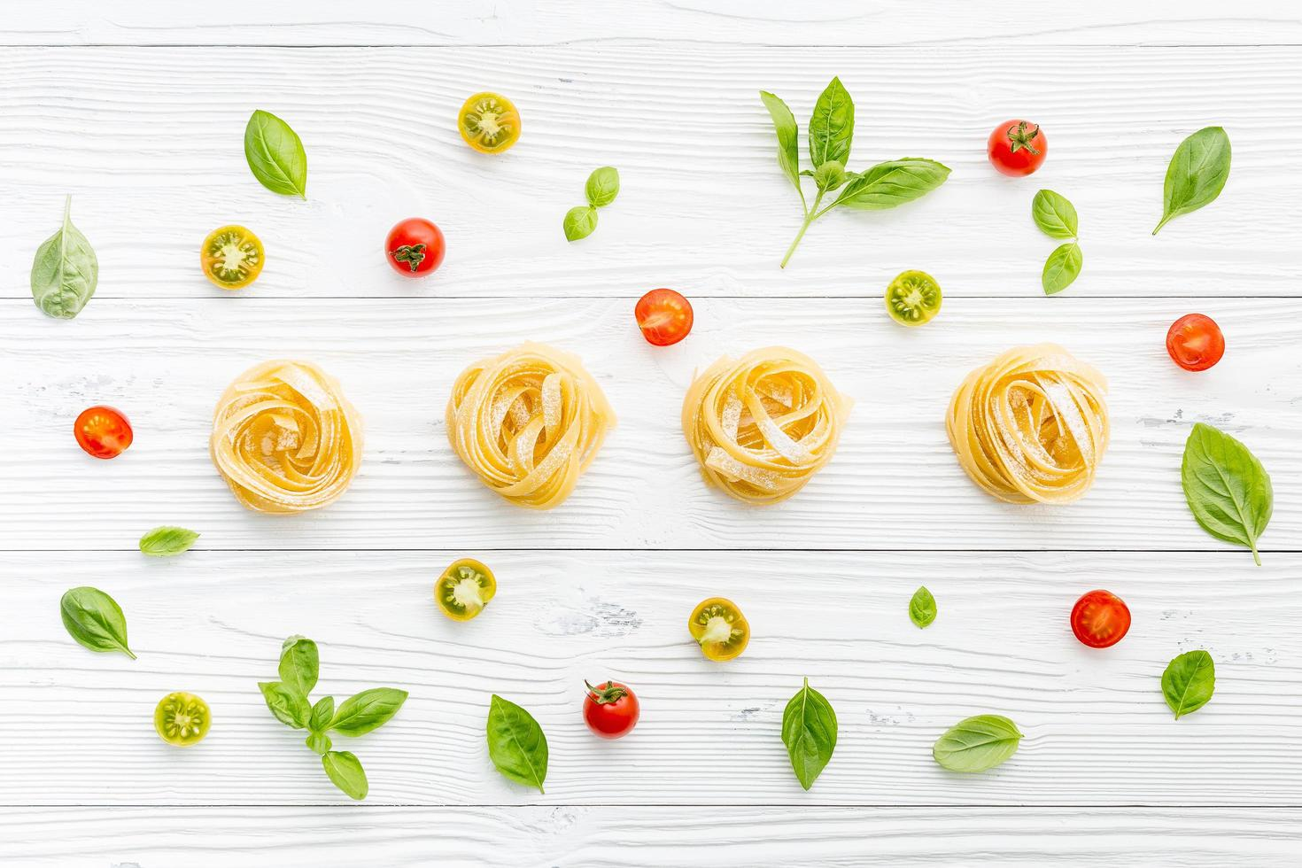 Fresh pasta, tomatoes, and basil photo