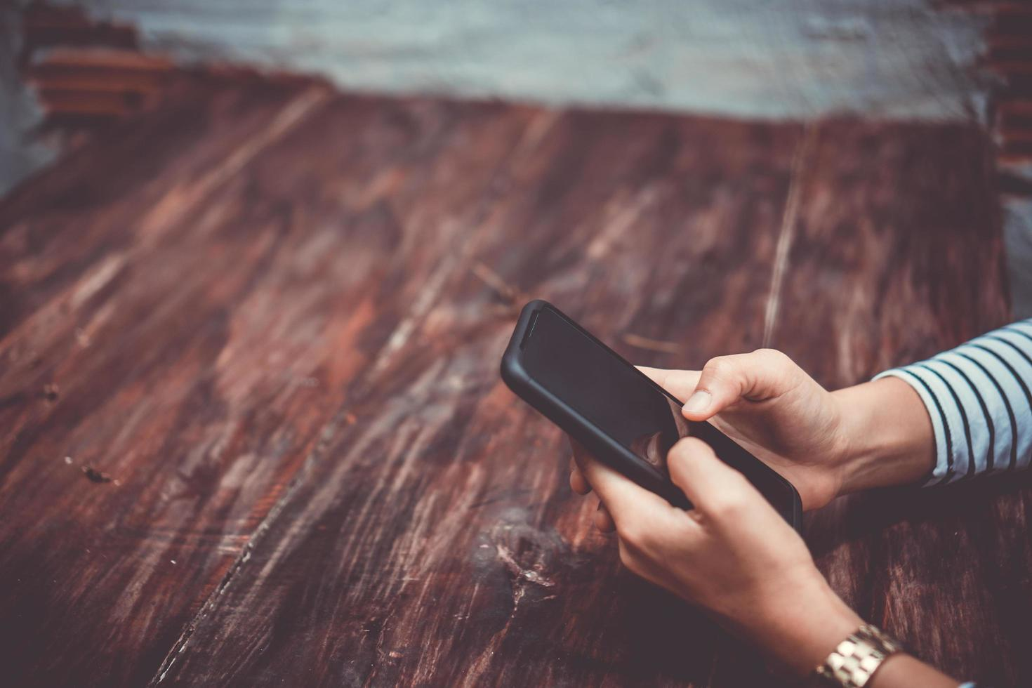 Woman using a smartphone at cafe shop photo