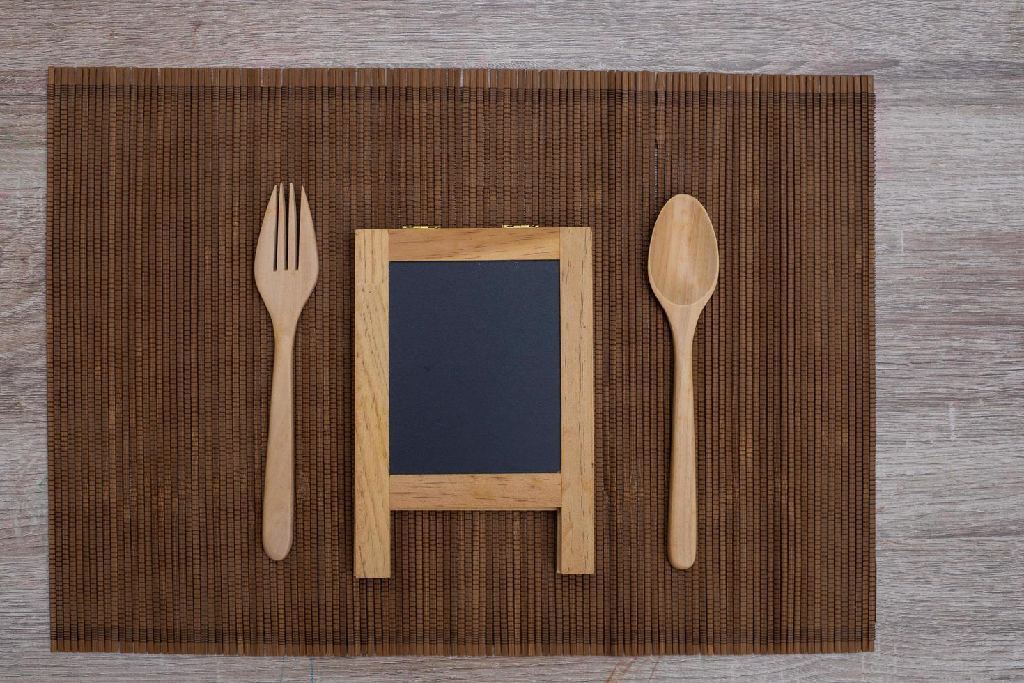 Chalkboard and wooden flatware photo