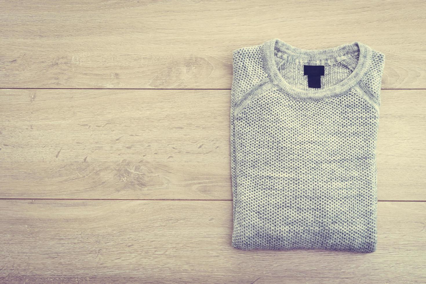 Sweater on wooden background photo