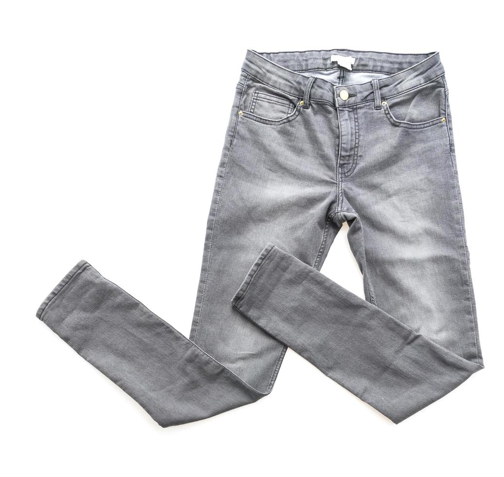 Gray jeans on white background photo