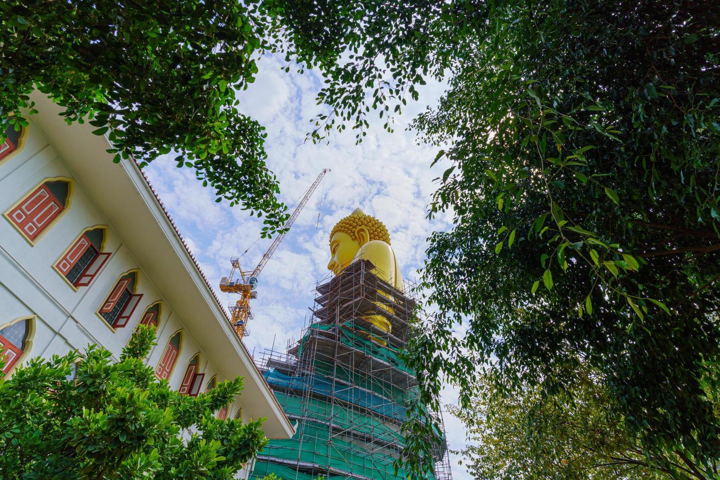 Big golden Buddha in Wat Paknam in Bangkok, Thailand photo