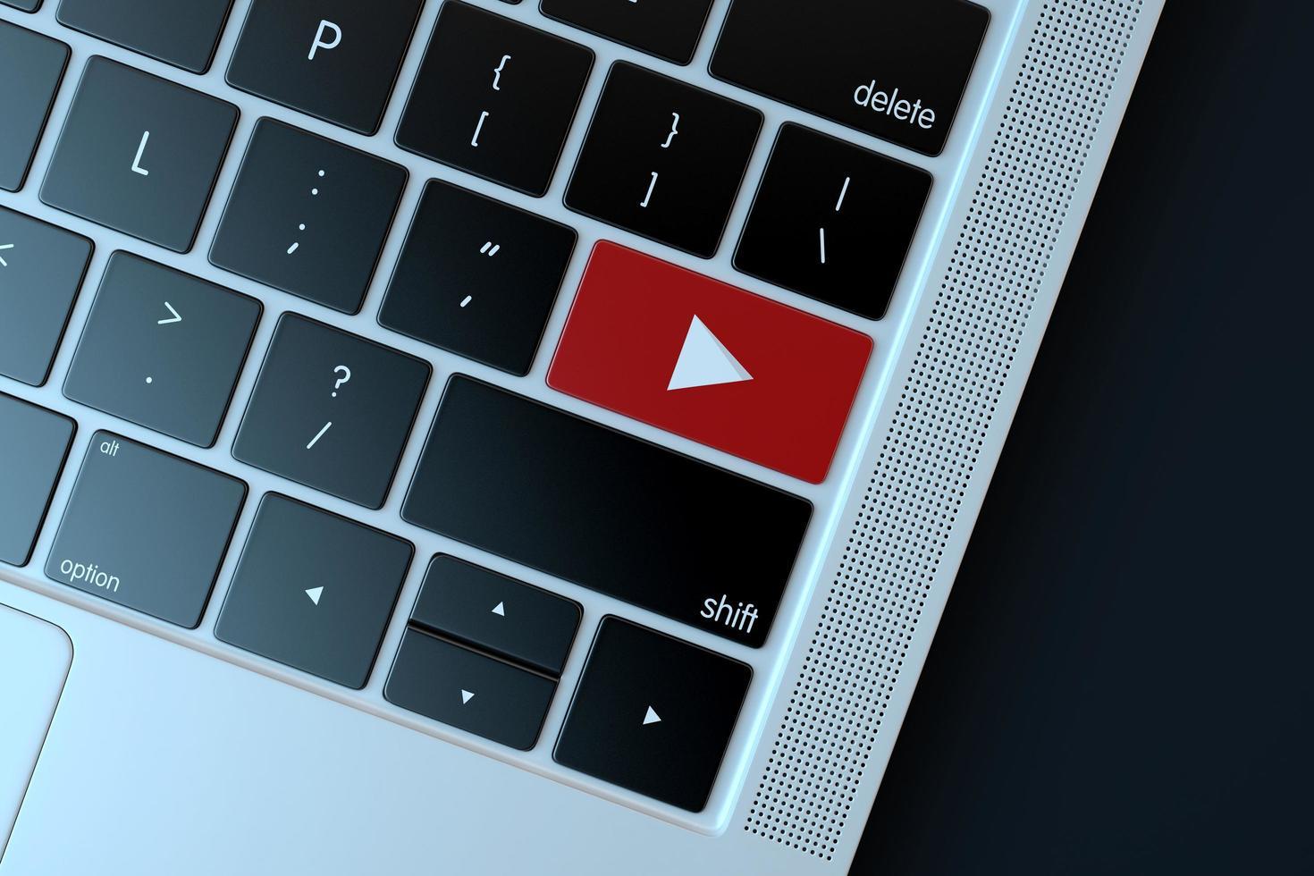 2018: editorial ilustrativa del símbolo de youtube sobre el teclado de la computadora foto