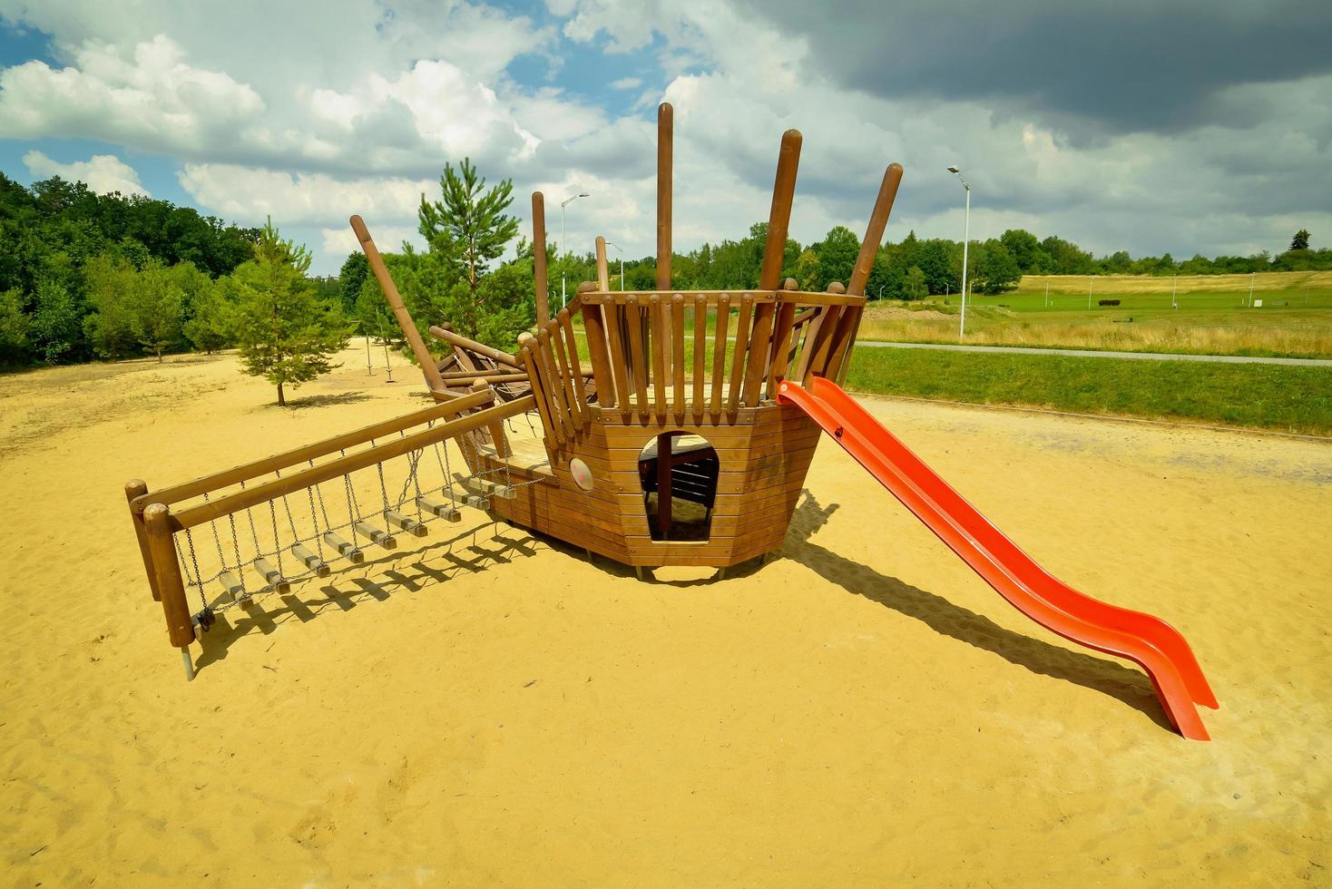 Modern equipped kids playground on a sunny day photo