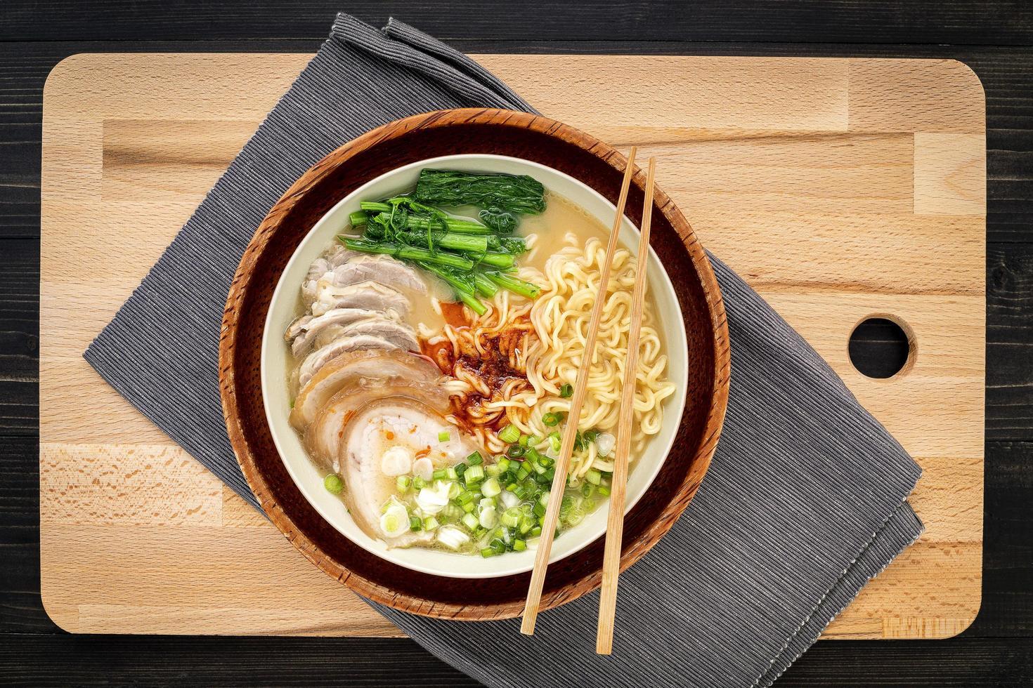 Bowl of ramen on a cutting board photo