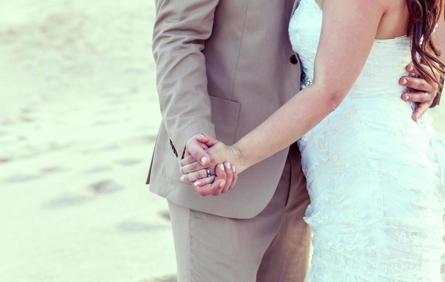 Bride and groom on a tropical beach photo