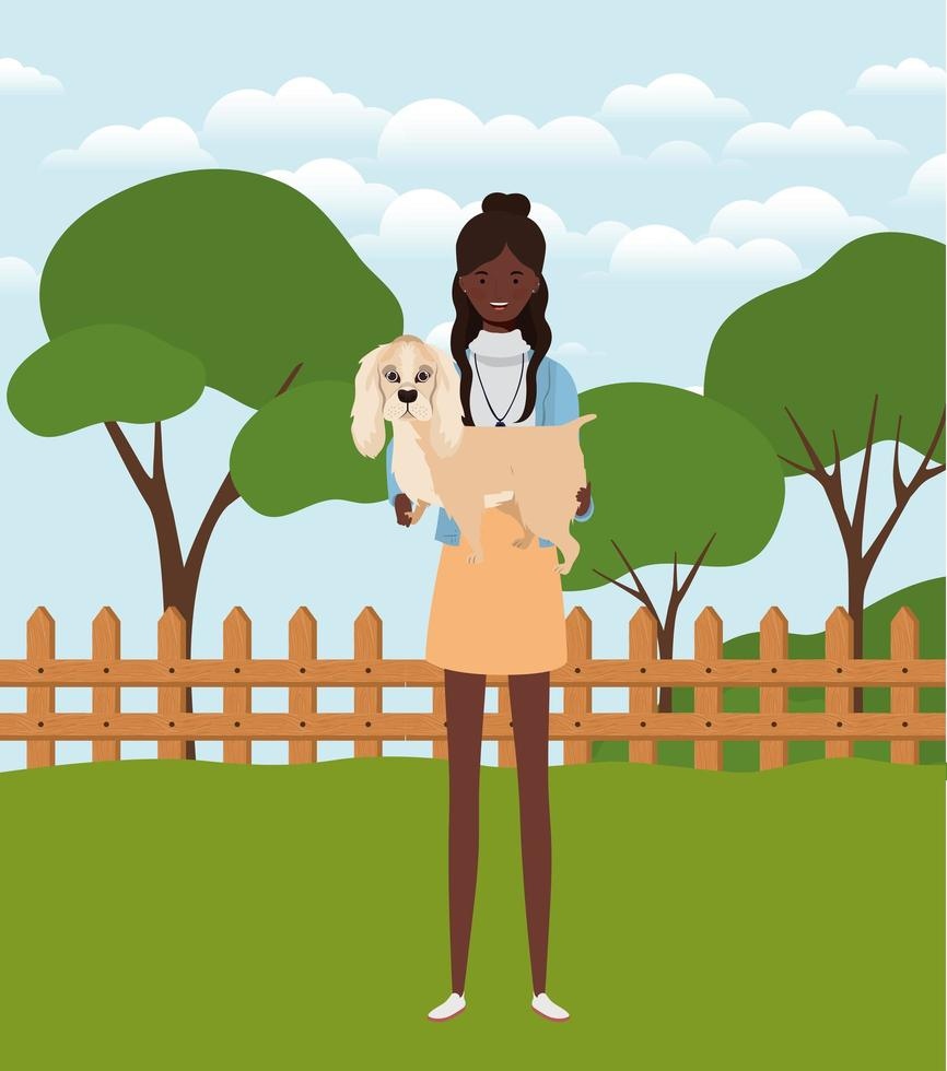young afro woman lifting cute dog in the field vector