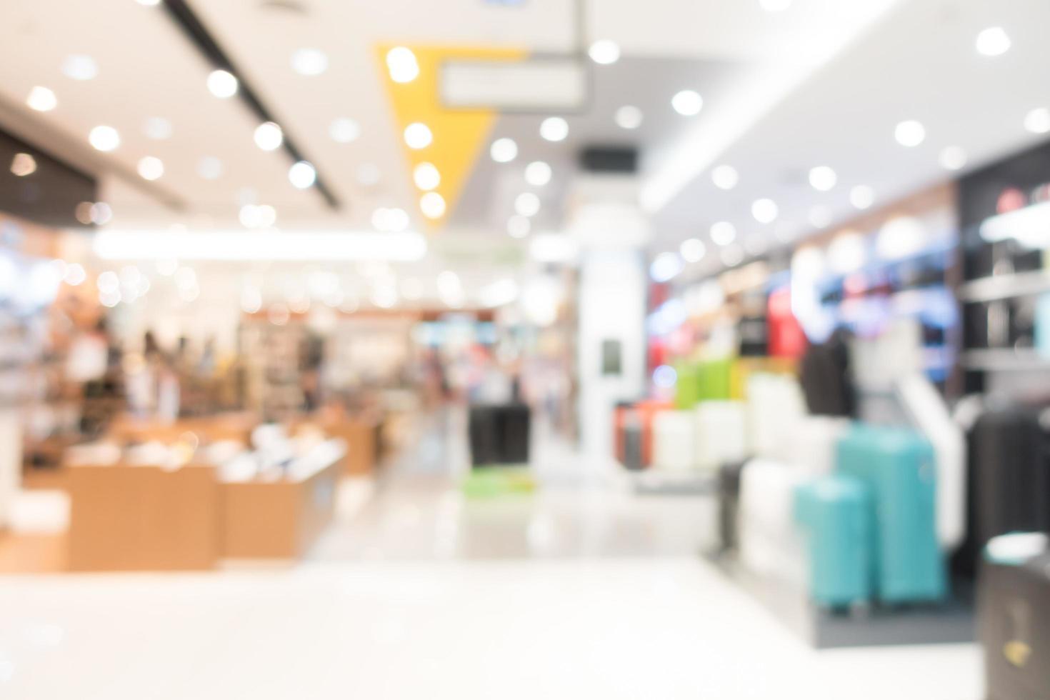 interior del centro comercial desenfocado foto