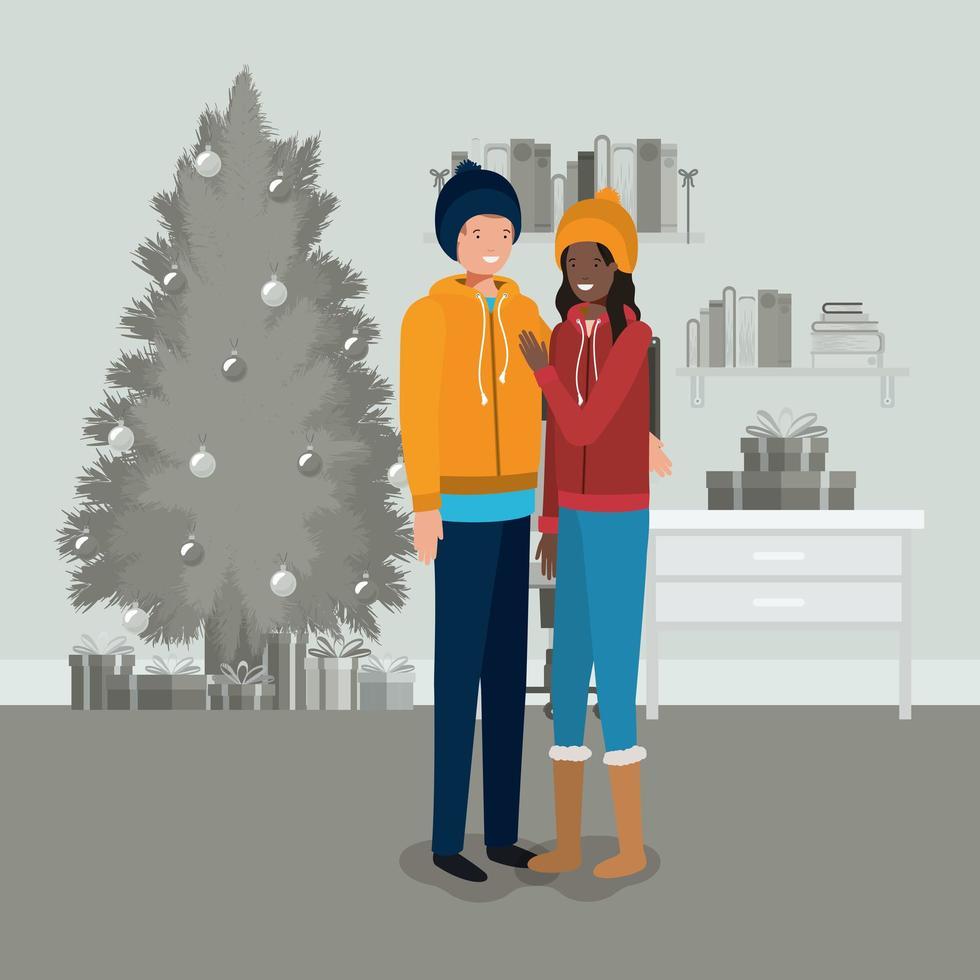 pareja interracial celebrando la navidad vector