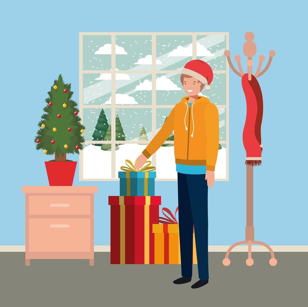 niño joven con pino y regalos de navidad vector