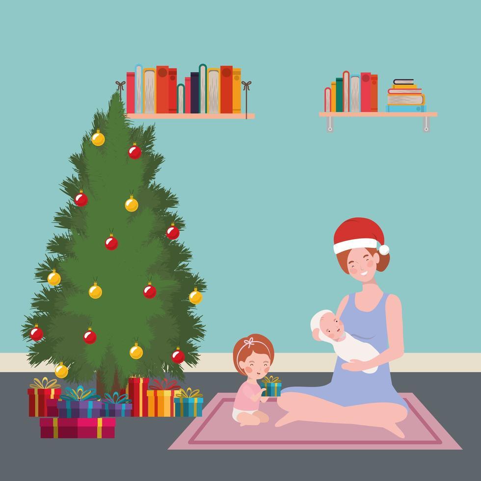 madre y bebés con pino celebración de navidad vector