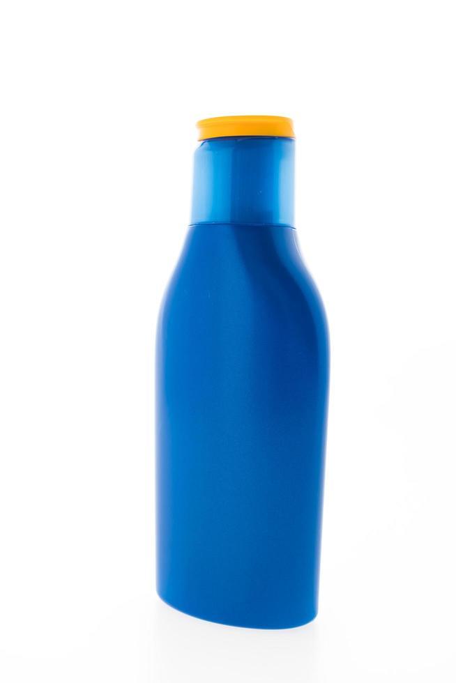 botella cosmética azul en blanco foto