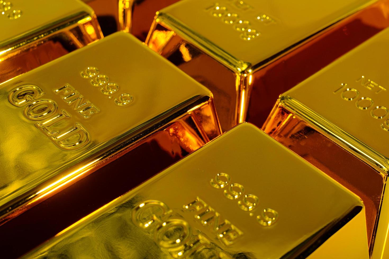 Close up of shiny gold bars on a white background photo