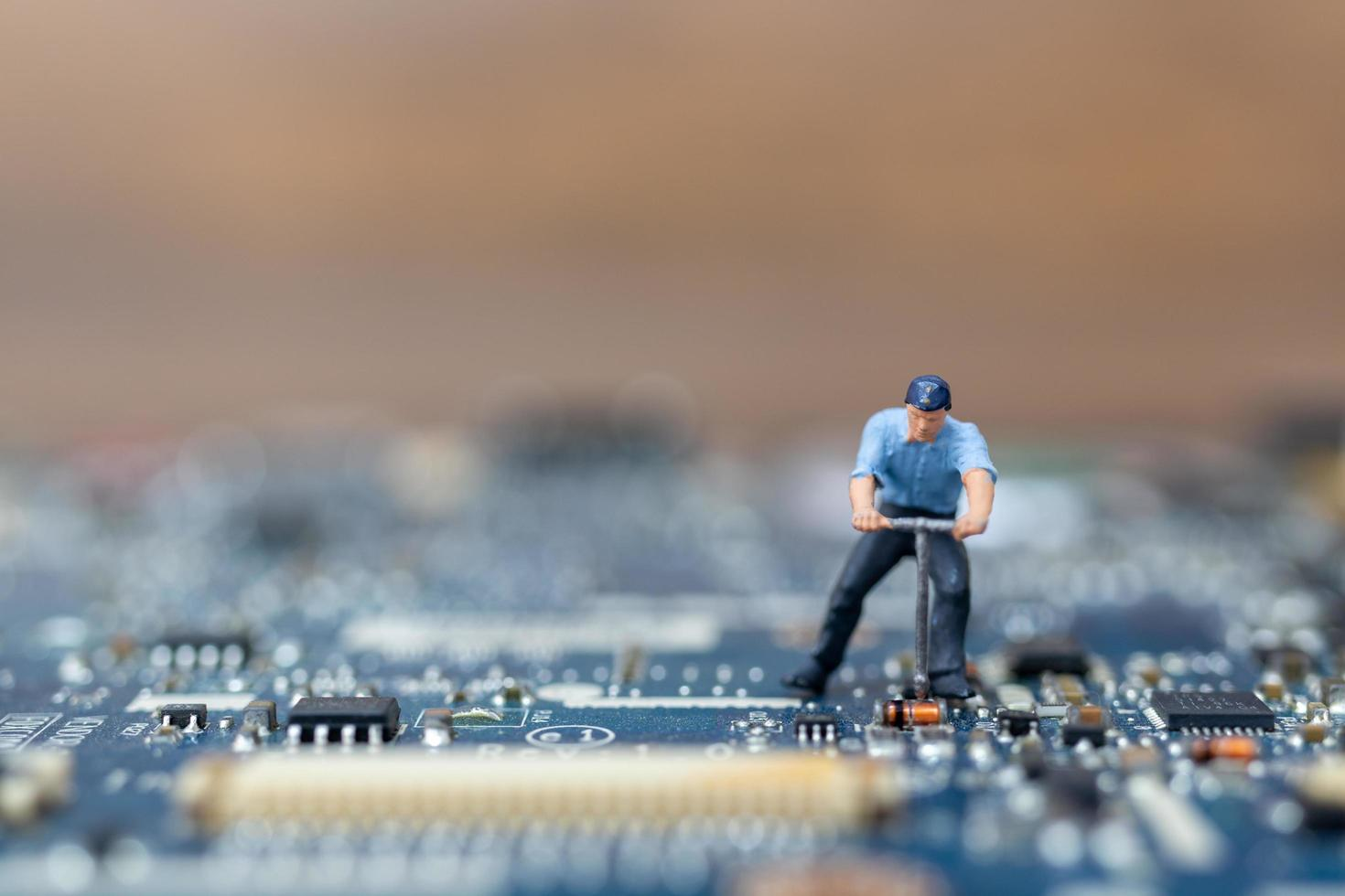 Miniature person working on a CPU board, technology concept photo