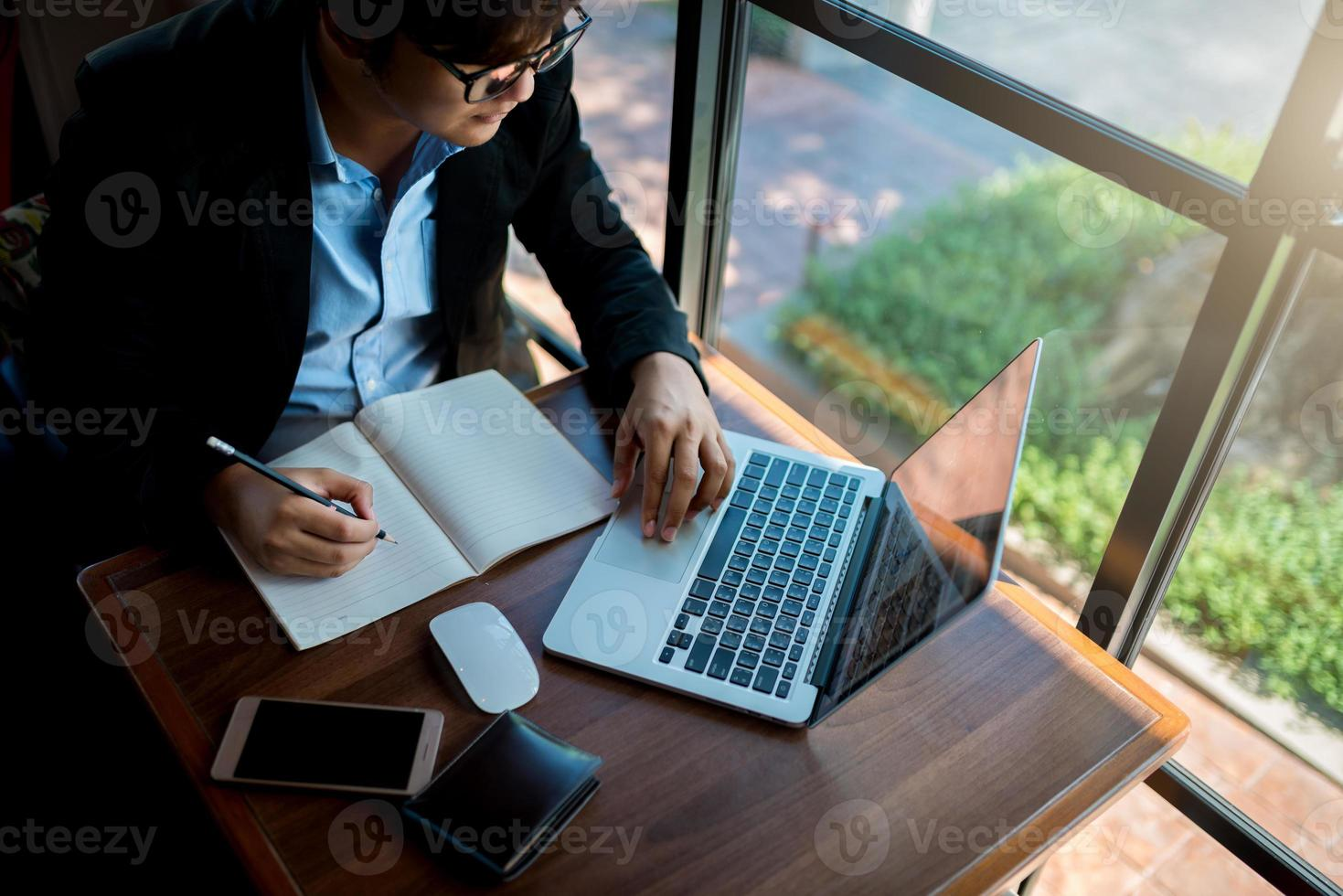 Businessman working on a laptop photo