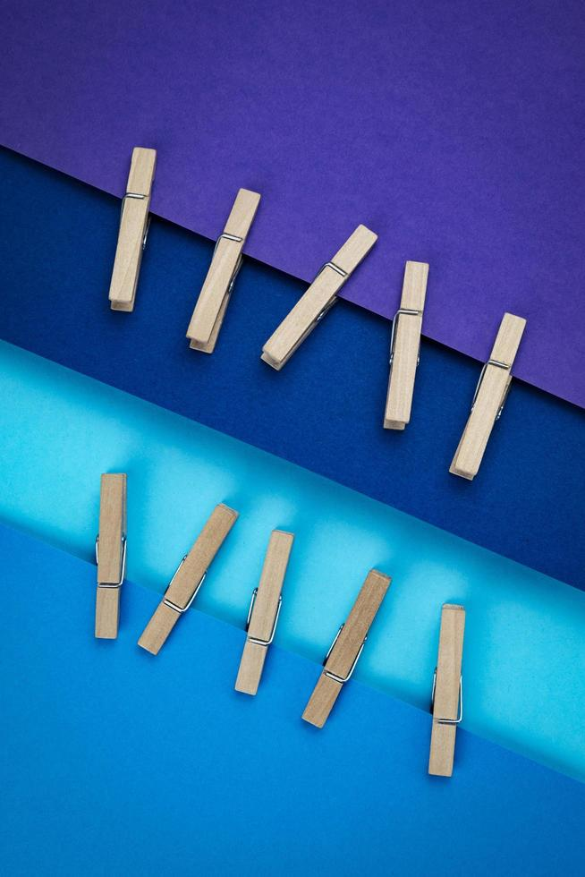 Clothespins attached to blue and purple paper photo