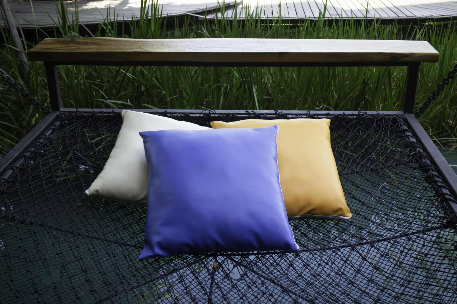 Colorful pillows on net hammock photo