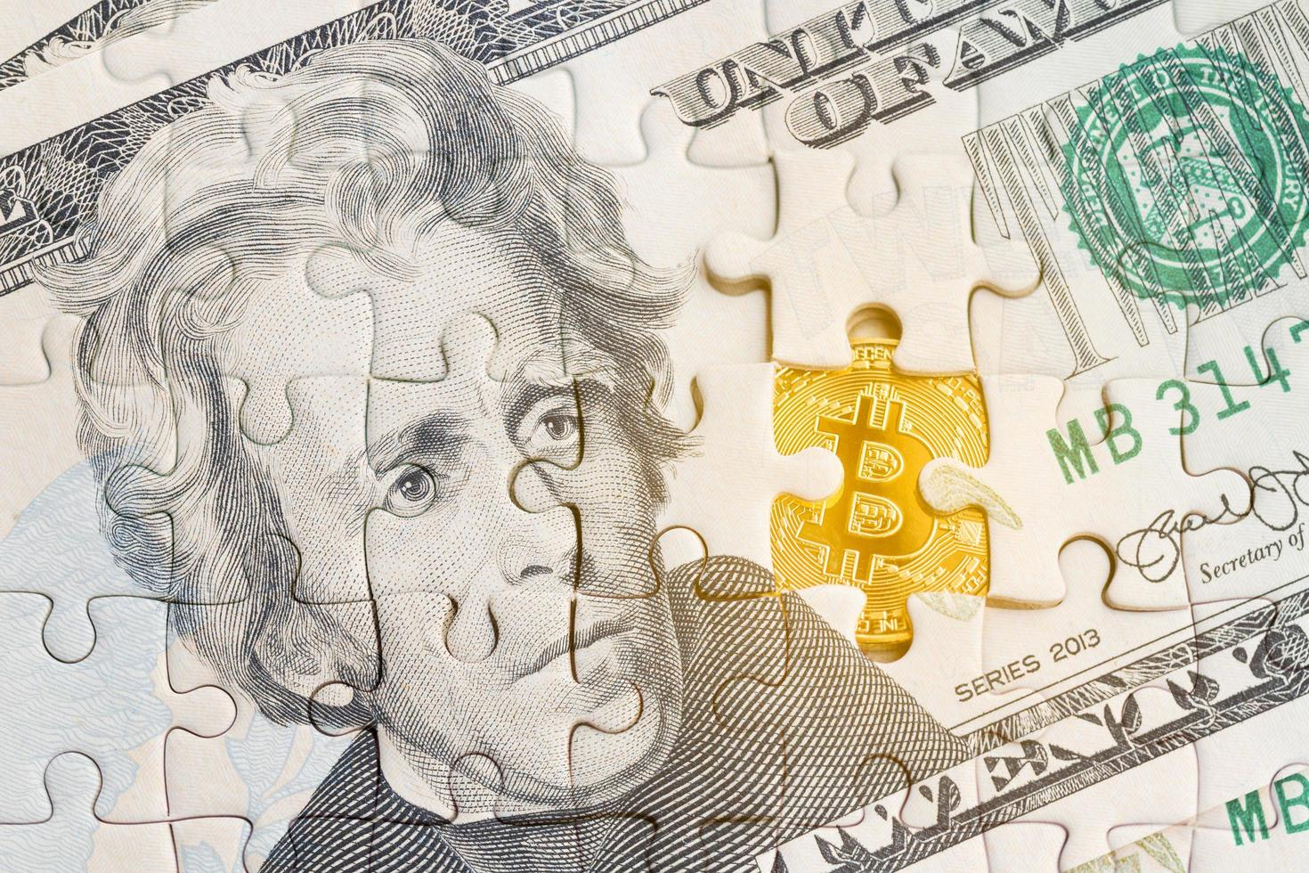US banknote with a jigsaw puzzle pattern on with a golden bitcoin symbol photo