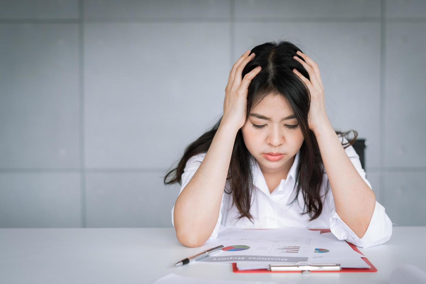 Asian businesswoman feeling tired and stressed photo