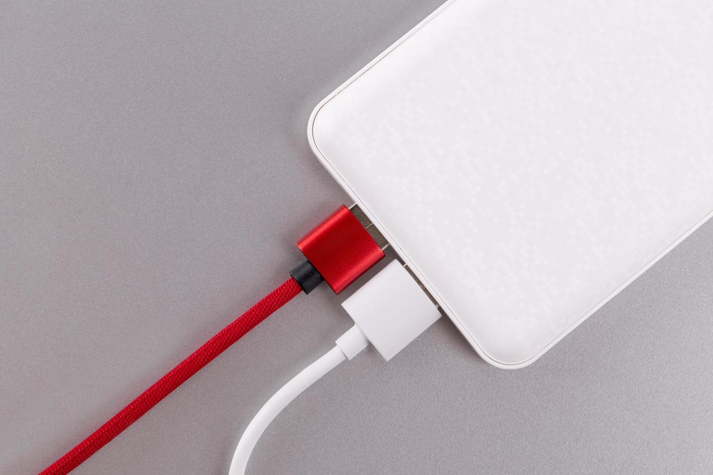 Power bank on a gray background photo