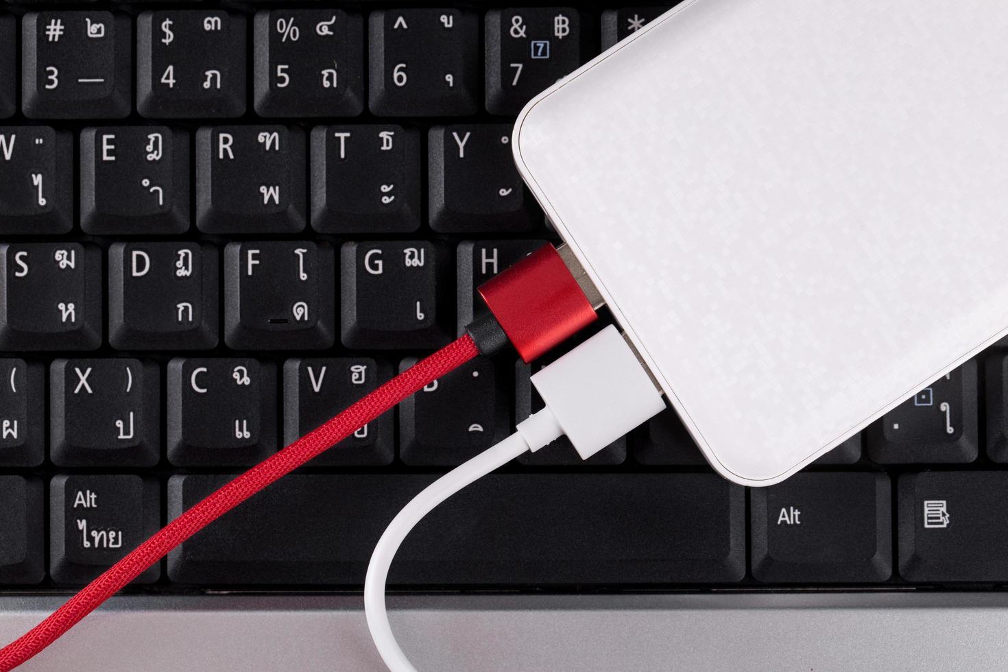 Power bank on a keyboard photo