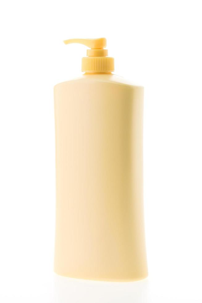 botella de loción en blanco foto