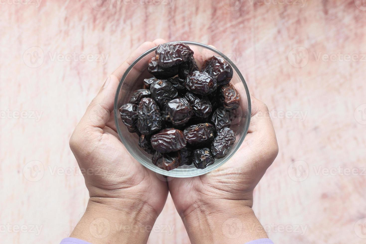 Close up of dried dates in a bowl photo