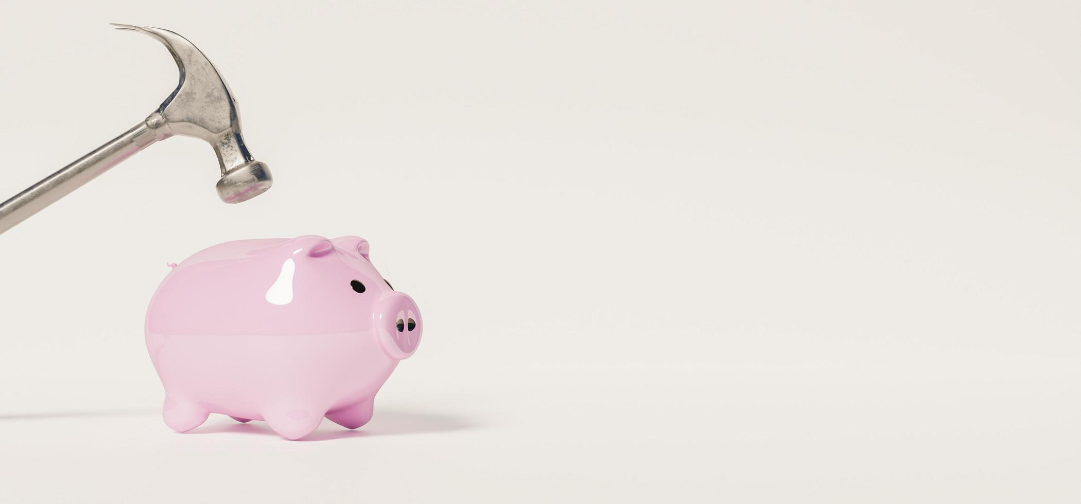 3D banner of small pink piggy bank with a hammer on top photo