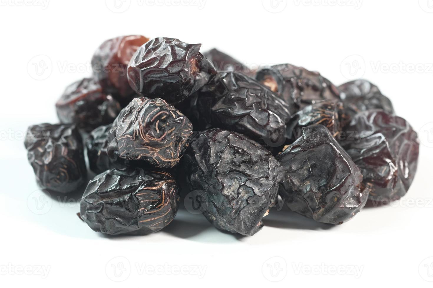Close up of fresh dates on white background photo