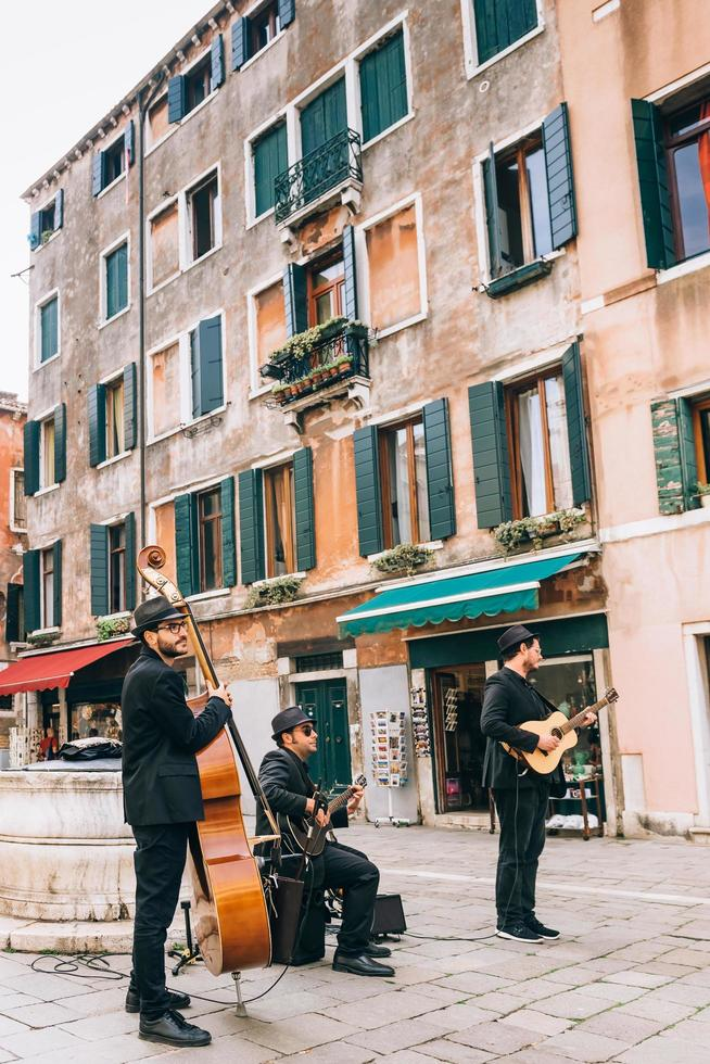 Venice, Italy 2017- Street musicians on the square of Venice photo