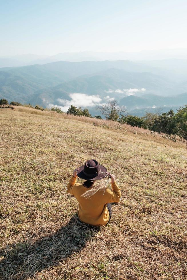 Woman in a hat on a mountain photo