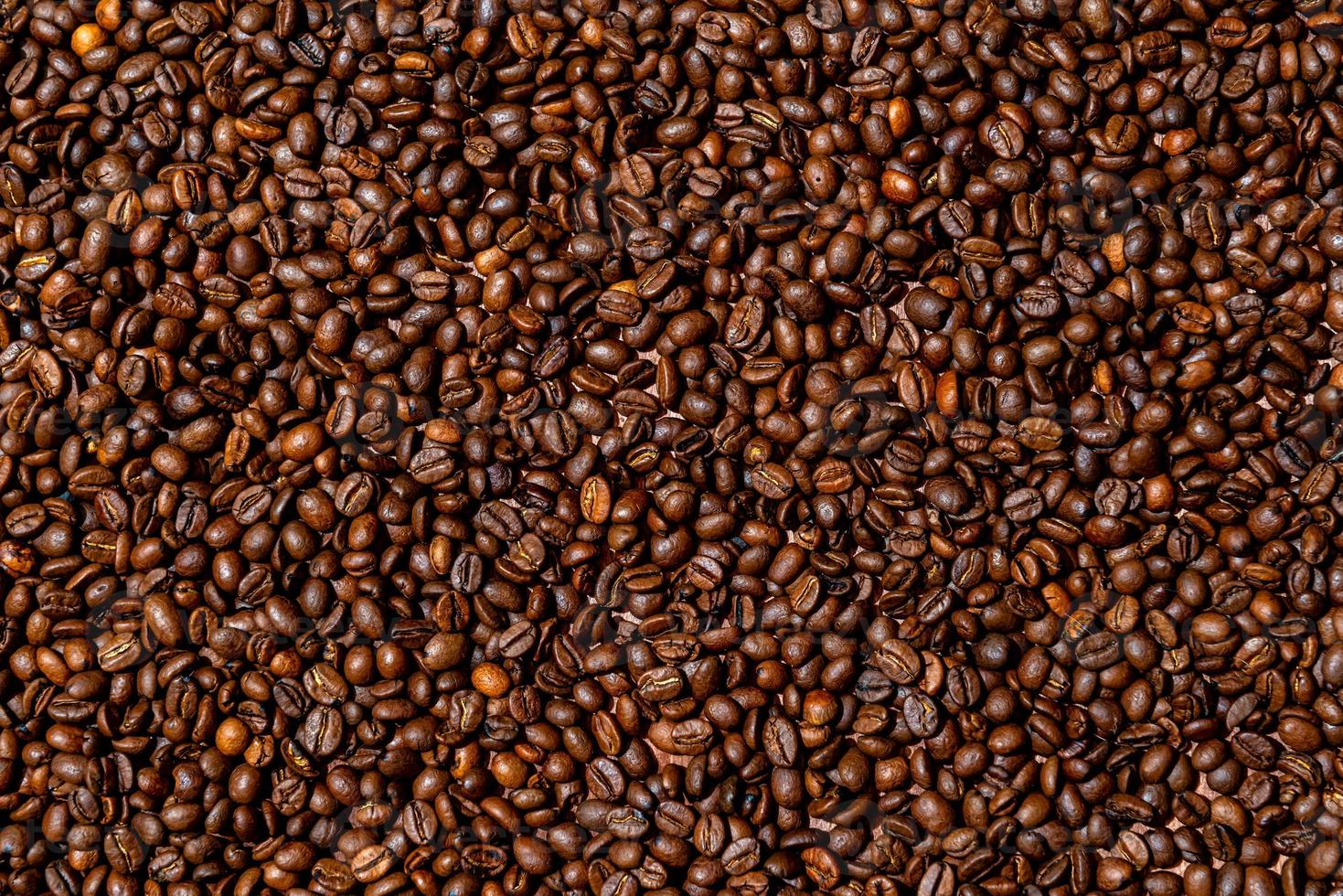 Close-up of brown, roasted coffee beans background photo