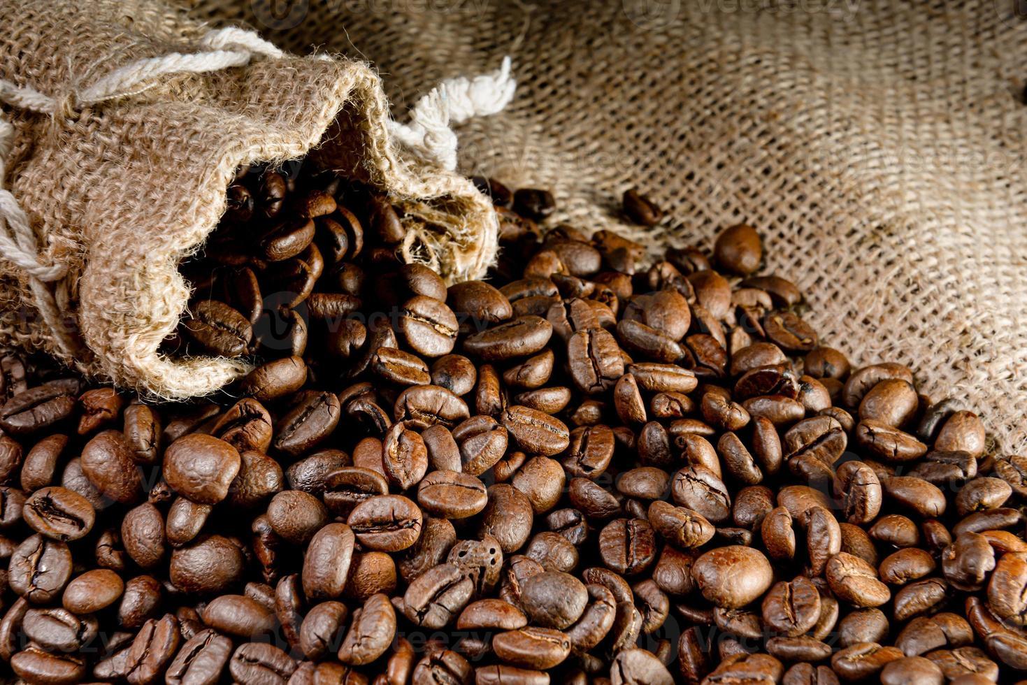 Coffee beans in a linen bag, selective focus photo