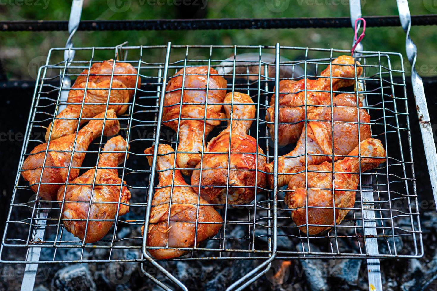 Meat on skewers fried on the grill in the open air photo