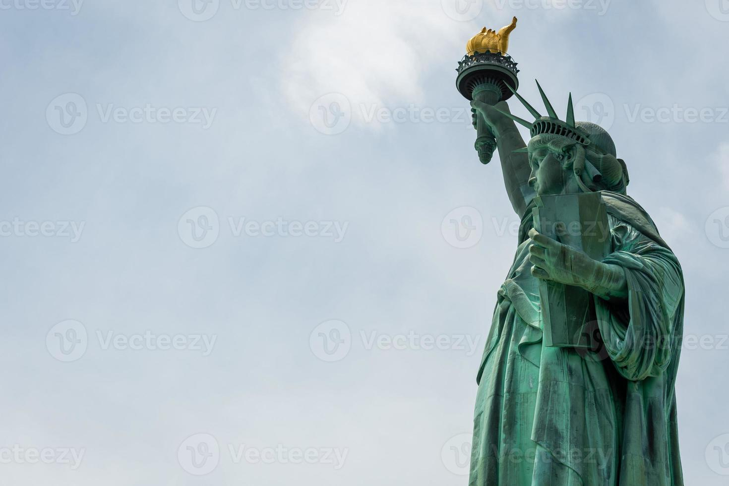Statue of Liberty close-up on a sunny day photo