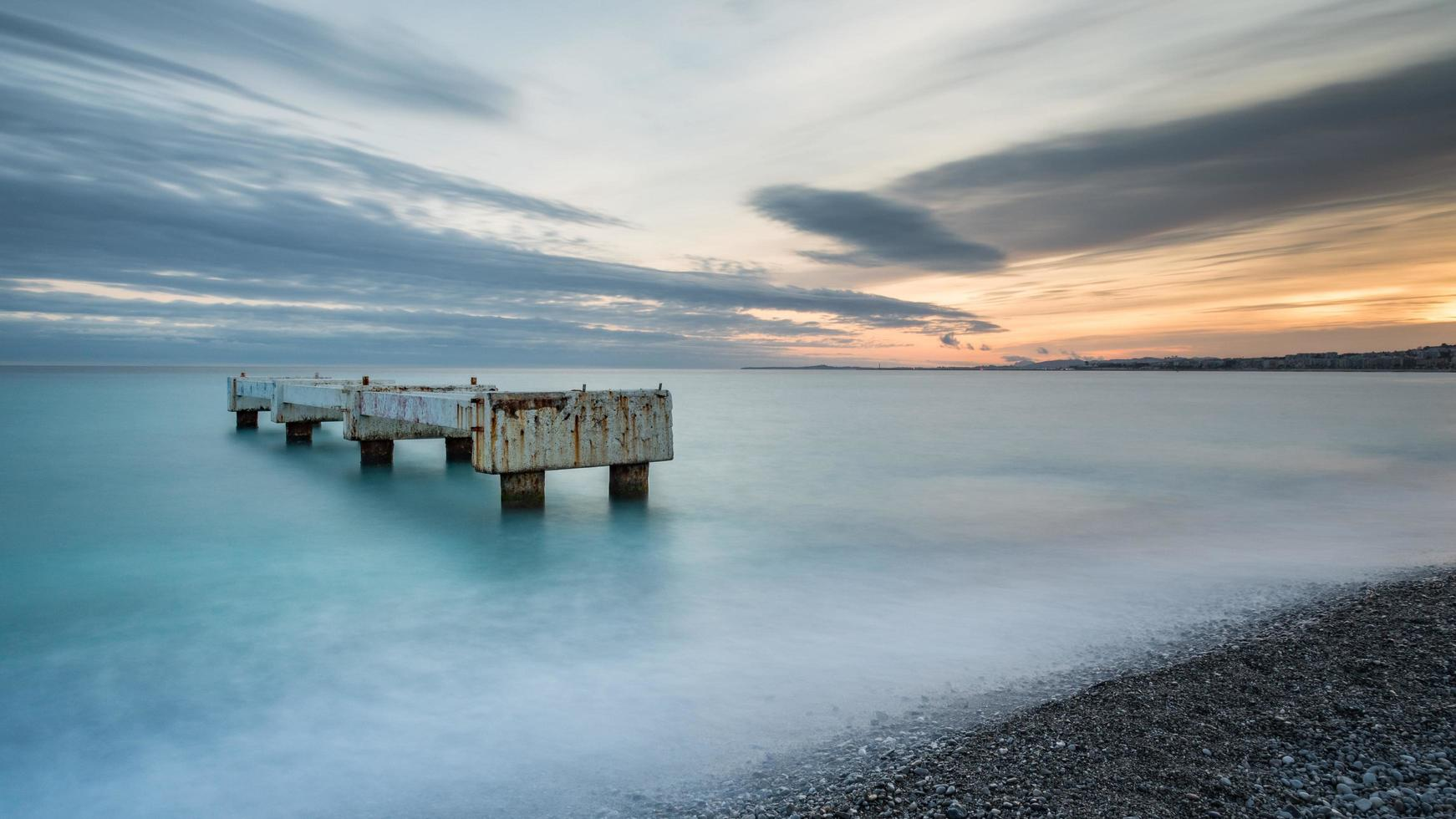 Long exposure of a beach during sunset in Nice, France photo