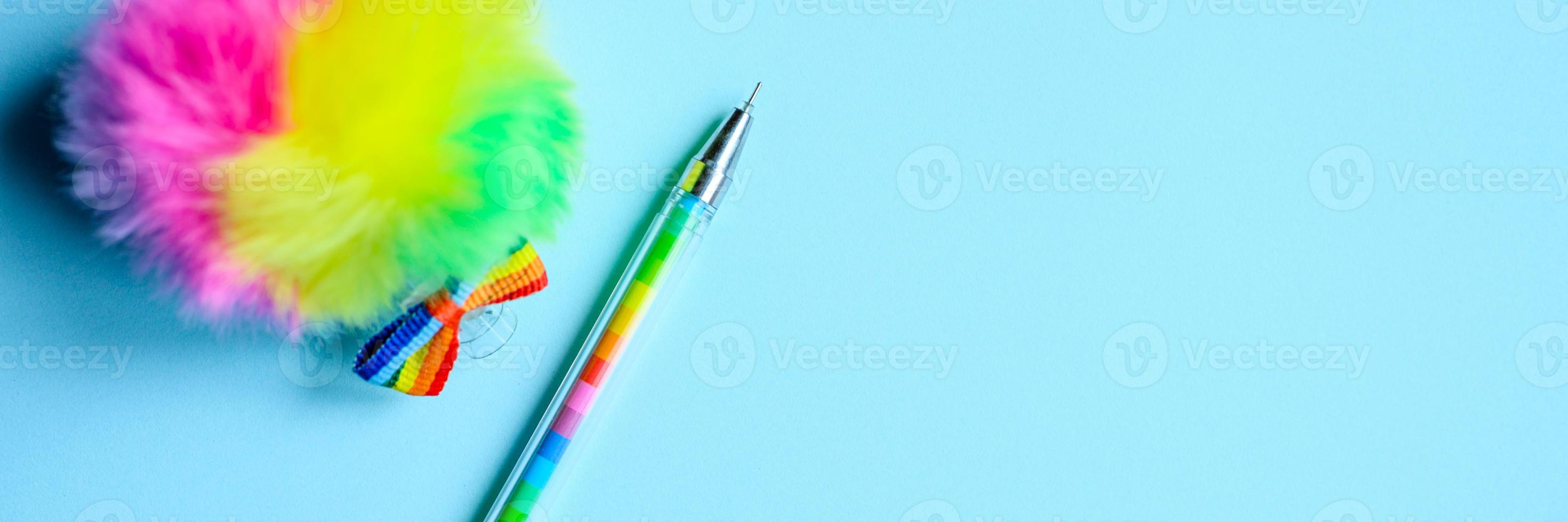 Multi-colored pen on blue background photo