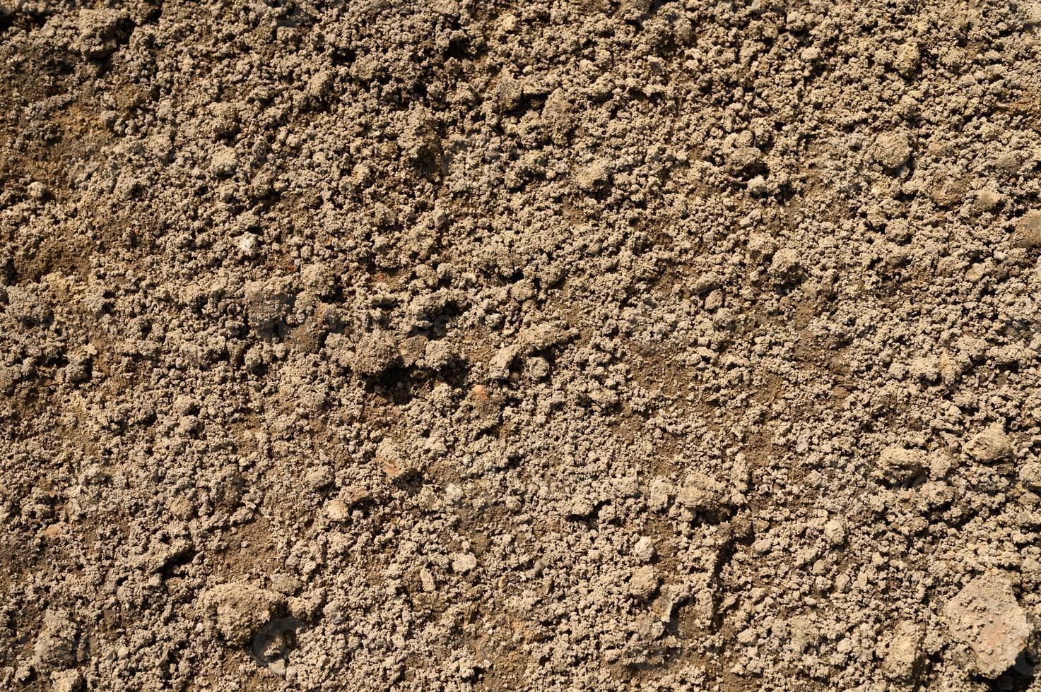 textura de fondo de la superficie lisa del suelo de la tierra foto
