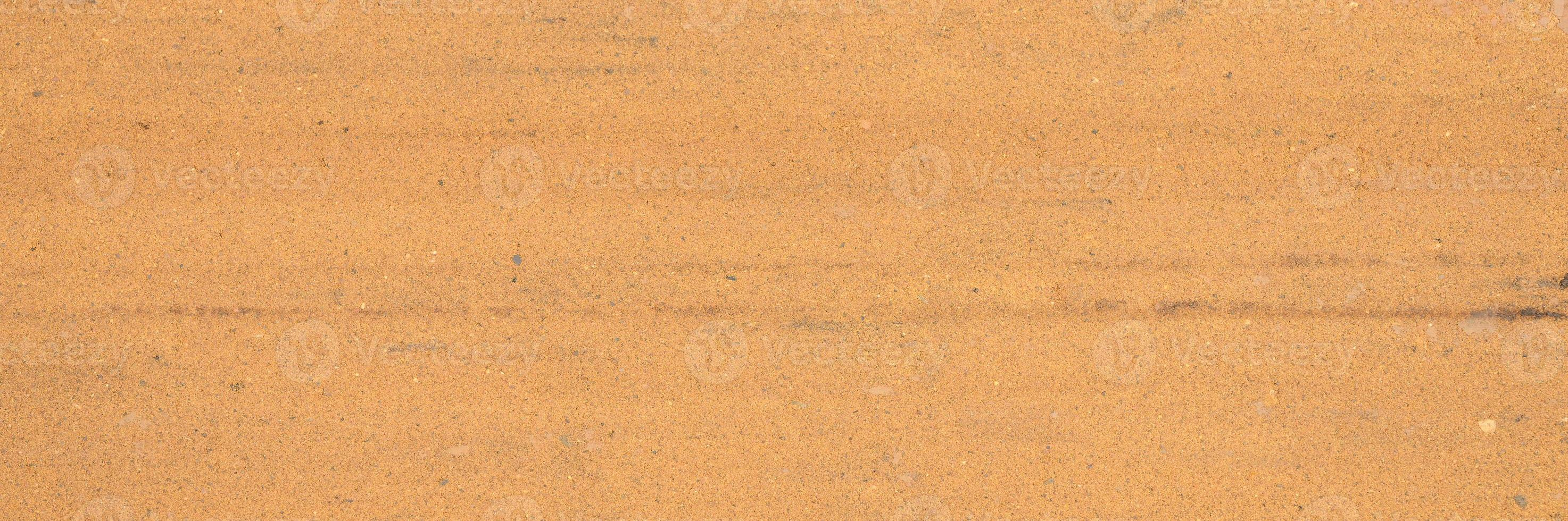 Background texture from the smooth surface of the sand photo