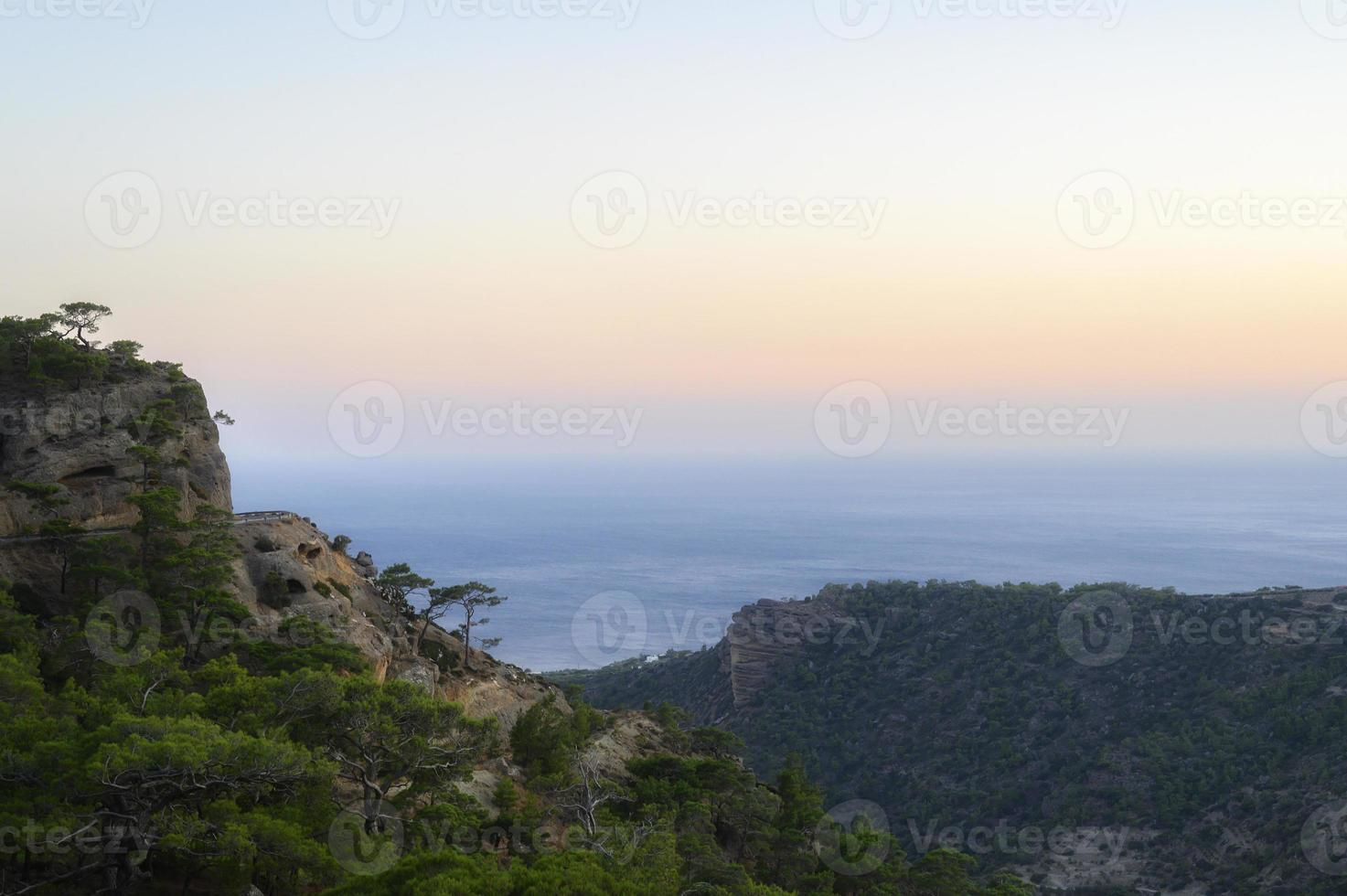 Dusk mountain landscape with views of the Mediterranean sea photo