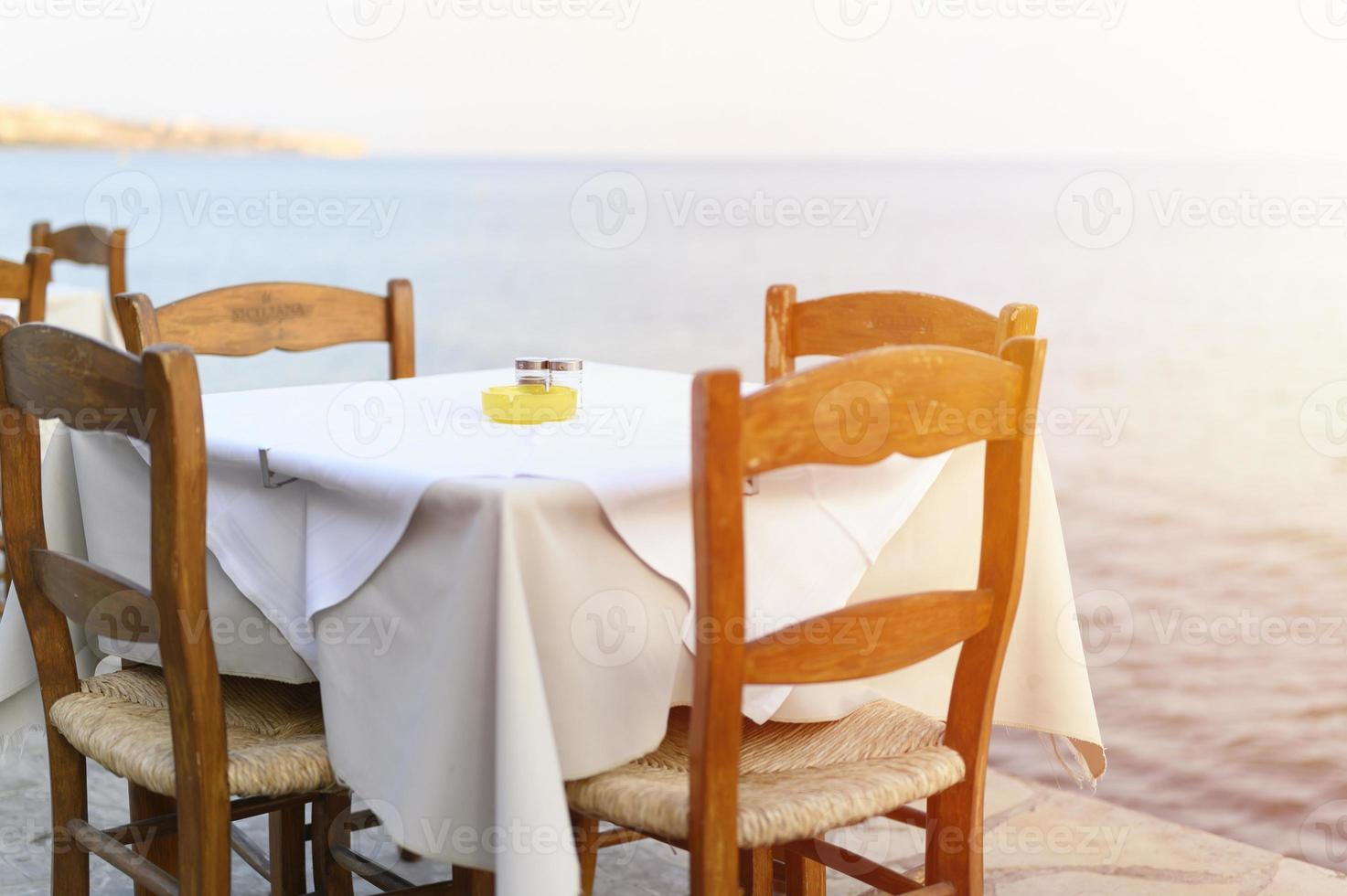 Cafe tables on the sea mediterranean embankment photo