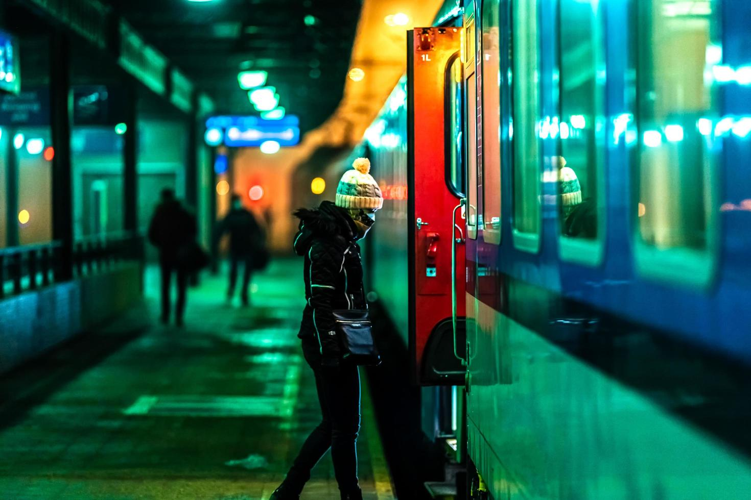 Woman boarding a night train at the station photo