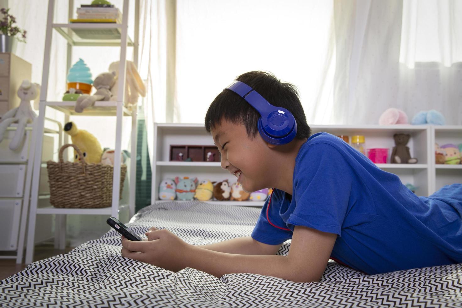 Boy enjoying listening to music photo