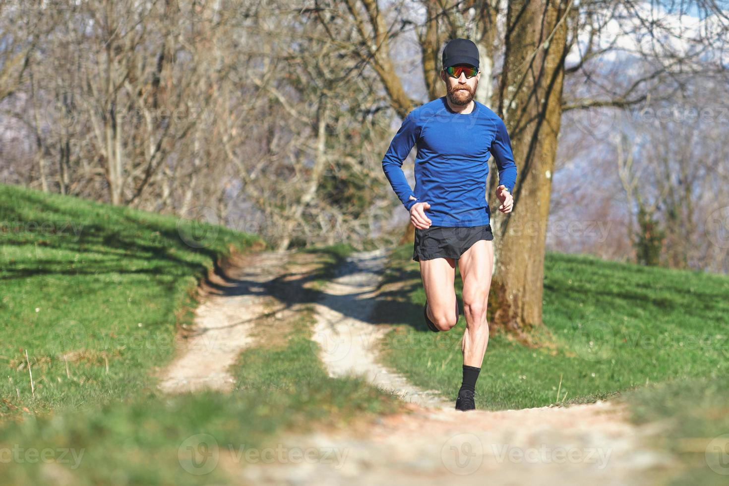 Marathon runner on a trail photo