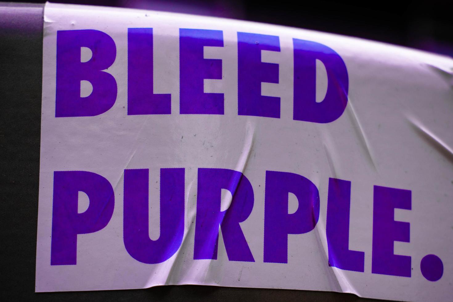 Bleed purple sign photo