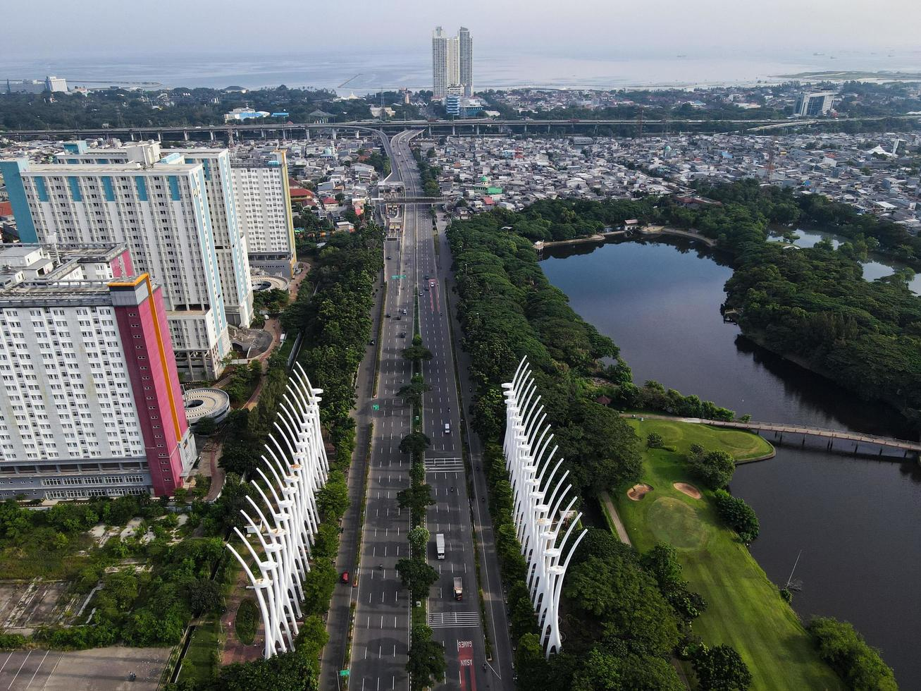 Jakarta, Indonesia 2021- Aerial view of highway in the morning and buildings photo