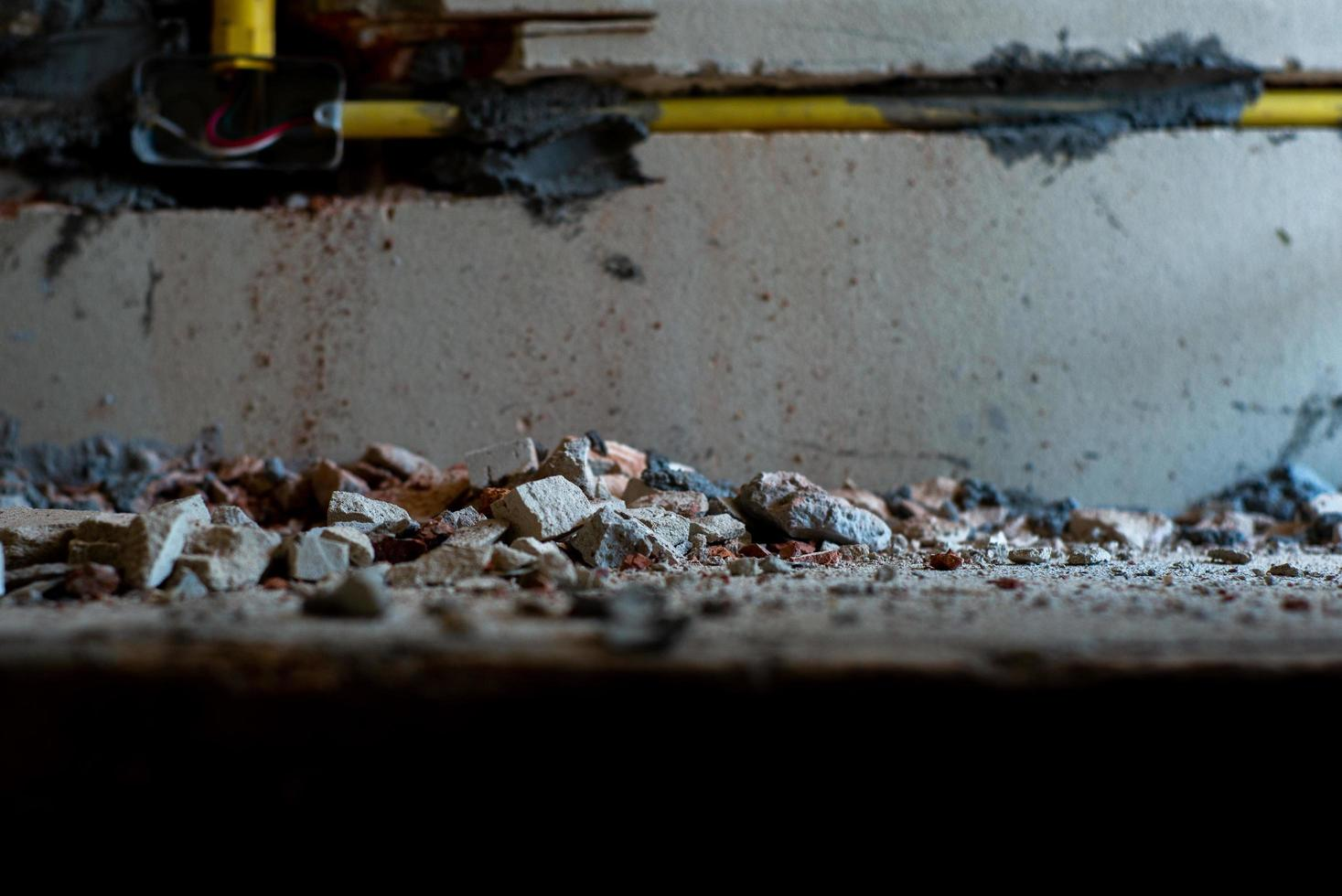Selective focus picture of crushed concrete lump with blurred broken plastered cement photo
