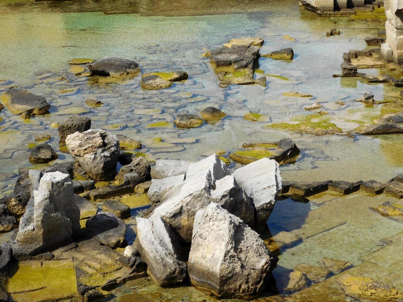Rocks in a pond photo