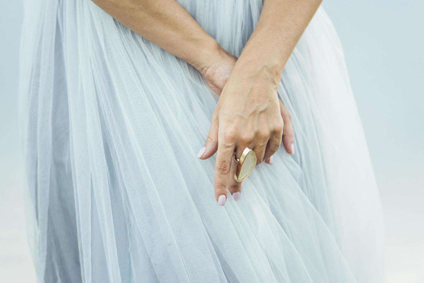 Bride wearing chunky gold ring photo